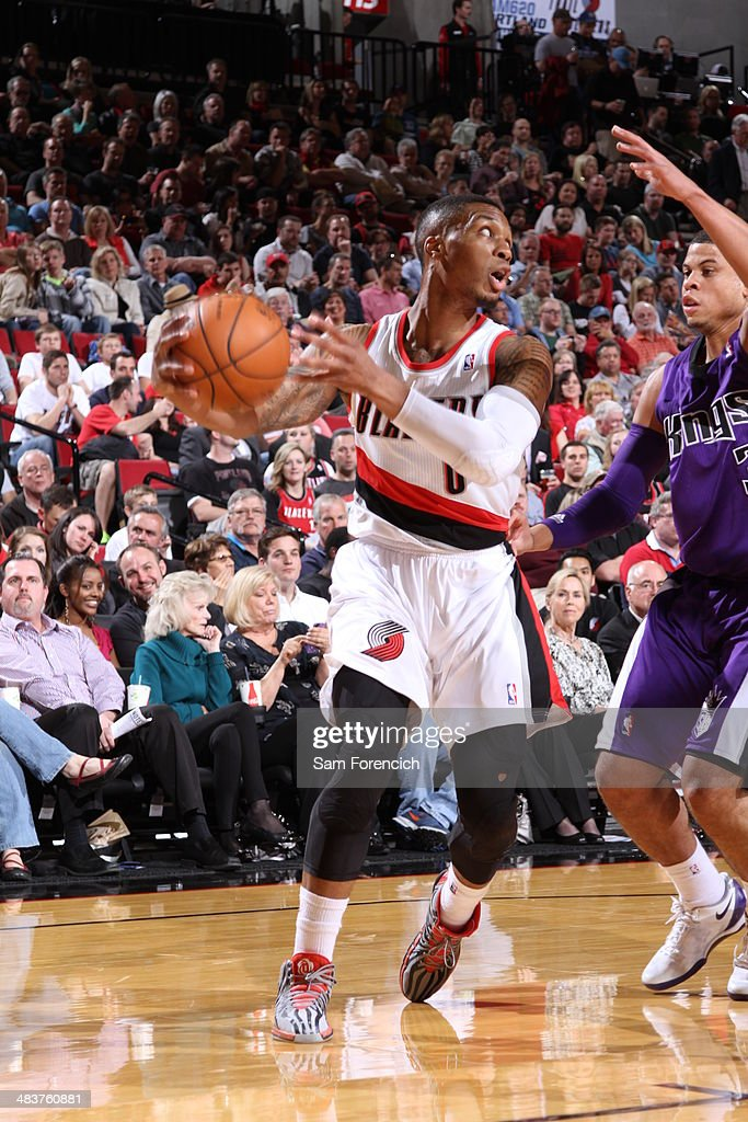 <a gi-track='captionPersonalityLinkClicked' href=/galleries/search?phrase=Damian+Lillard&family=editorial&specificpeople=6598327 ng-click='$event.stopPropagation()'>Damian Lillard</a> #0 of the Portland Trail Blazers looks to pass the ball against the Phoenix Suns on April 9, 2014 at the Moda Center Arena in Portland, Oregon.
