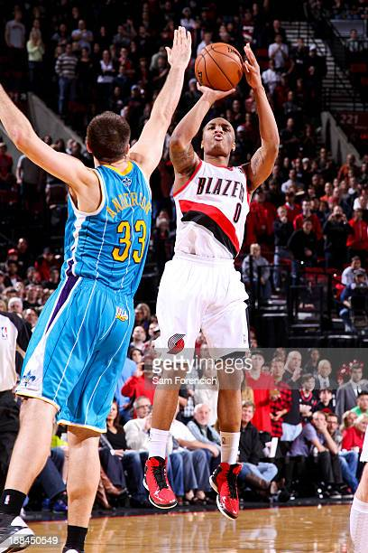 Damian Lillard of the Portland Trail Blazers makes a gamewinning threepointer at the buzzer against Ryan Anderson of the New Orleans Hornets on...
