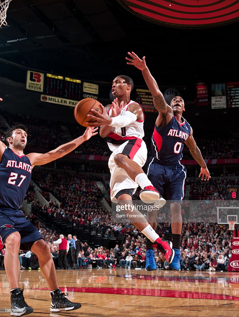 <a gi-track='captionPersonalityLinkClicked' href=/galleries/search?phrase=Damian+Lillard&family=editorial&specificpeople=6598327 ng-click='$event.stopPropagation()'>Damian Lillard</a> #0 of the Portland Trail Blazers makes a pass against <a gi-track='captionPersonalityLinkClicked' href=/galleries/search?phrase=Zaza+Pachulia&family=editorial&specificpeople=202939 ng-click='$event.stopPropagation()'>Zaza Pachulia</a> #27 of the Atlanta Hawks on November 12, 2012 at the Rose Garden Arena in Portland, Oregon.