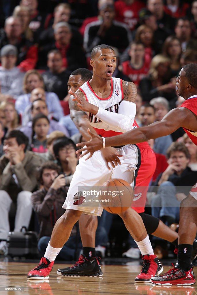 <a gi-track='captionPersonalityLinkClicked' href=/galleries/search?phrase=Damian+Lillard&family=editorial&specificpeople=6598327 ng-click='$event.stopPropagation()'>Damian Lillard</a> #0 of the Portland Trail Blazers makes a pass against the Los Angeles Clippers on November 8, 2012 at the Rose Garden Arena in Portland, Oregon.