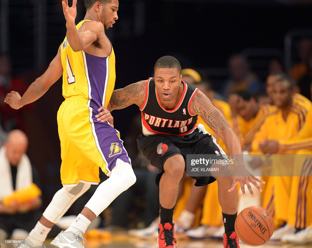 Damian Lillard (R) of the Portland Trail Blazers moves past Darius Morris (L) of the Los Angeles Lakers December 28, 2012 at Staples Center in Los Angeles, California. The Lakers rolled over the Blazers 104-87. AFP PHOTO / Joe KLAMAR