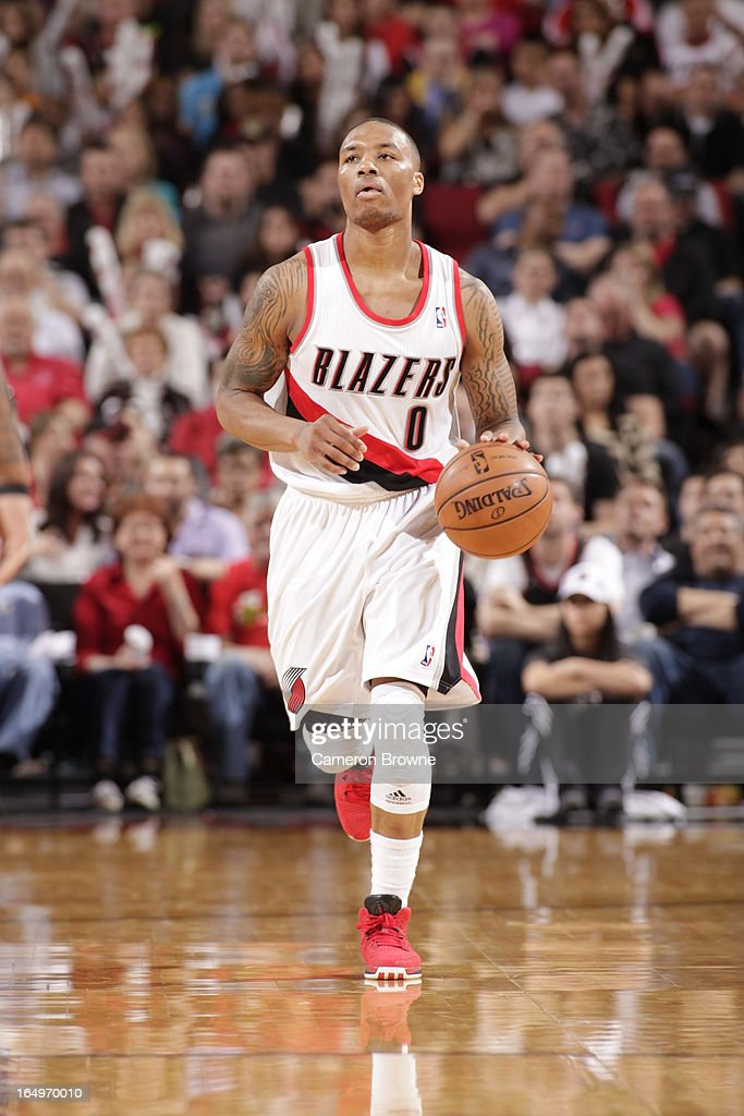 <a gi-track='captionPersonalityLinkClicked' href=/galleries/search?phrase=Damian+Lillard&family=editorial&specificpeople=6598327 ng-click='$event.stopPropagation()'>Damian Lillard</a> #0 of the Portland Trail Blazers moves the ball up-court against the Utah Jazz on March 29, 2013 at the Rose Garden Arena in Portland, Oregon.