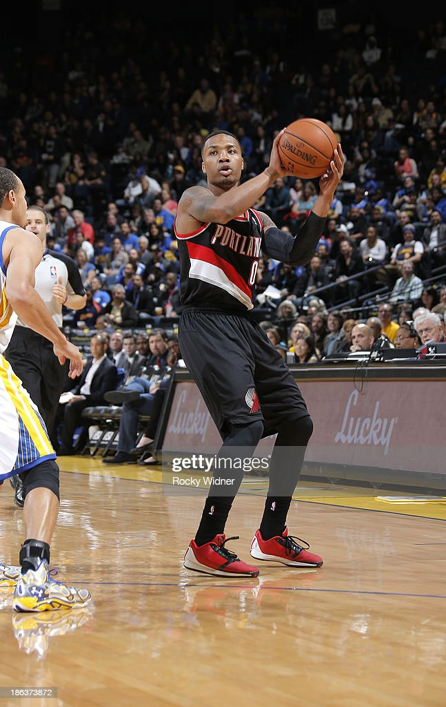 <a gi-track='captionPersonalityLinkClicked' href=/galleries/search?phrase=Damian+Lillard&family=editorial&specificpeople=6598327 ng-click='$event.stopPropagation()'>Damian Lillard</a> #0 of the Portland Trail Blazers passes against the Golden State Warriors on October 24, 2013 at Oracle Arena in Oakland, California.