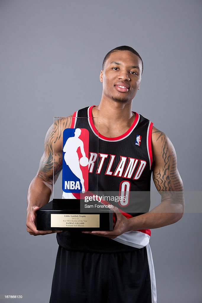 Damian Lillard #0 of the Portland Trail Blazers poses with the Eddie Gottlieb Trophy after winning the 2012-2013 Kia NBA Rookie of the Year award on May 1, 2013 at the Rose Garden Arena in Portland, Oregon.