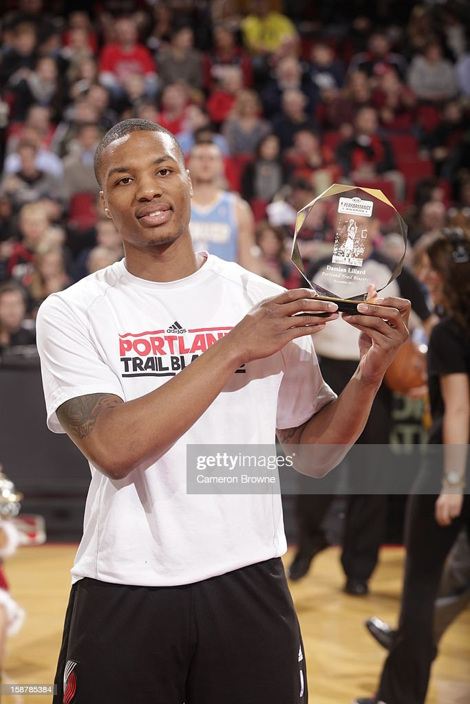 Damian Lillard #0 of the Portland Trail Blazers presenting his Kia Rookie of the Month award before the game against the Denver Nuggets on December 20, 2012 at the Rose Garden Arena in Portland, Oregon.