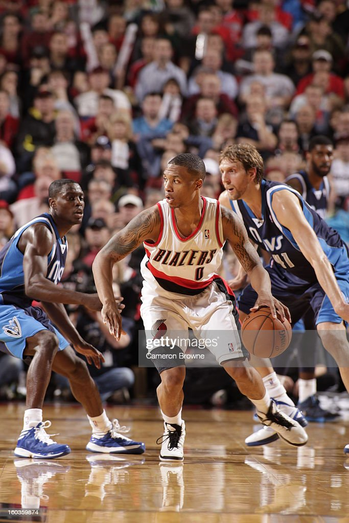 Damian Lillard #0 of the Portland Trail Blazers protects the ball during the game between the Dallas Mavericks and the Portland Trail Blazers on January 29, 2013 at the Rose Garden Arena in Portland, Oregon.