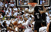 Damian Lillard of the Portland Trail Blazers puts in a shot past DeAndre Jordan of the Los Angeles Clippers in the first quarter of Game Three of the...