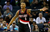 Damian Lillard of the Portland Trail Blazers reacts after a play against the Charlotte Hornets during their game at Time Warner Cable Arena on...