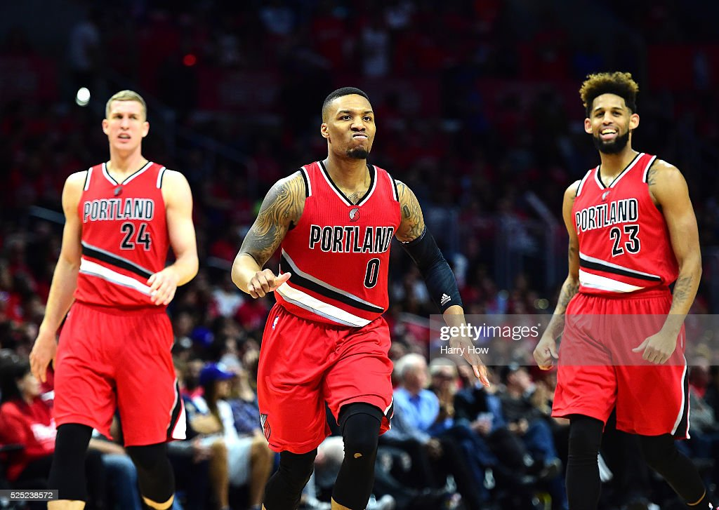 <a gi-track='captionPersonalityLinkClicked' href=/galleries/search?phrase=Damian+Lillard&family=editorial&specificpeople=6598327 ng-click='$event.stopPropagation()'>Damian Lillard</a> #0 of the Portland Trail Blazers reacts as he heads to the bench with <a gi-track='captionPersonalityLinkClicked' href=/galleries/search?phrase=Mason+Plumlee&family=editorial&specificpeople=5792012 ng-click='$event.stopPropagation()'>Mason Plumlee</a> #24 and <a gi-track='captionPersonalityLinkClicked' href=/galleries/search?phrase=Allen+Crabbe&family=editorial&specificpeople=7447799 ng-click='$event.stopPropagation()'>Allen Crabbe</a> #23 leading the Los Angeles Clippers late during the fourth quarter in Game Five of the Western Conference Quarterfinals during the 2016 NBA Playoffs on April 27, 2016 in Los Angeles, California. The Trail Blazers won 108-98.