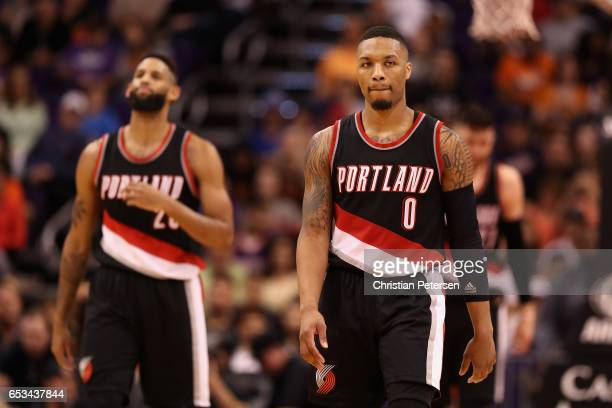 Damian Lillard of the Portland Trail Blazers reacts during the NBA game against the Phoenix Suns at Talking Stick Resort Arena on March 12 2017 in...