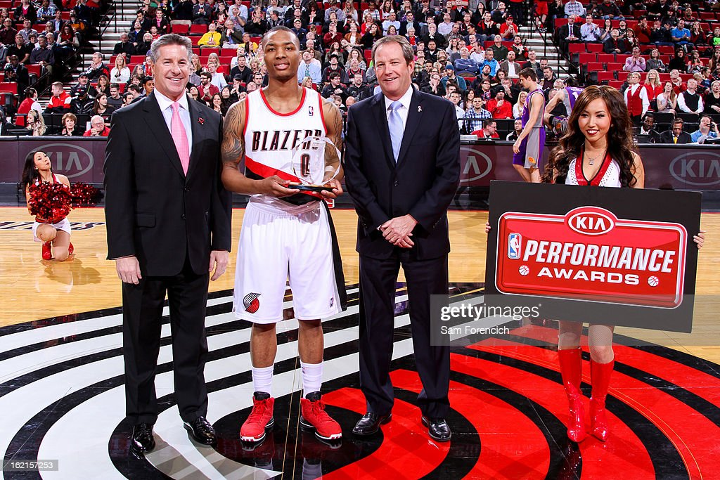 Damian Lillard #0 of the Portland Trail Blazers receives the Kia Performance Award for Western Conference Rookie of the Month for January 2013 before a game against the Phoenix Suns on February 19, 2013 at the Rose Garden Arena in Portland, Oregon.