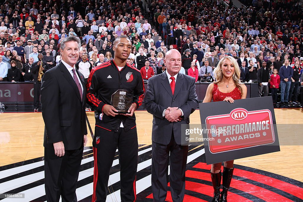 <a gi-track='captionPersonalityLinkClicked' href=/galleries/search?phrase=Damian+Lillard&family=editorial&specificpeople=6598327 ng-click='$event.stopPropagation()'>Damian Lillard</a> #0 of the Portland Trail Blazers receives the Kia Rookie of the Month Award during the game against the Miami Heat on January 10, 2013 at the Rose Garden Arena in Portland, Oregon.