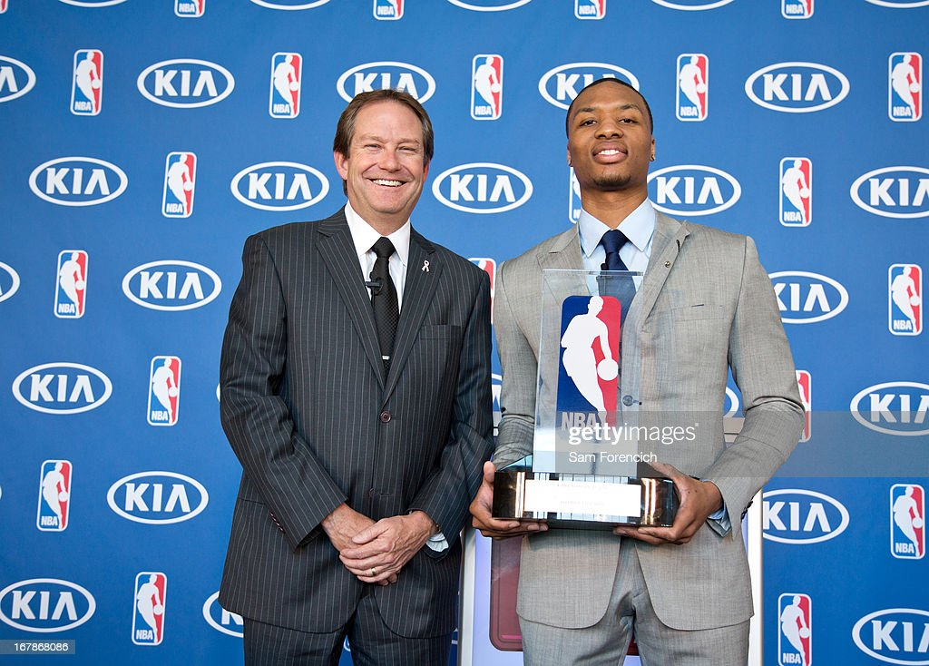 Damian Lillard #0 of the Portland Trail Blazers, right, and Phil Kelley of Kia Motors America pose with the Eddie Gottlieb Trophy after Lillard won the 2012-2013 Kia NBA Rookie of the Year award on May 1, 2013 at the Rose Garden Arena in Portland, Oregon.