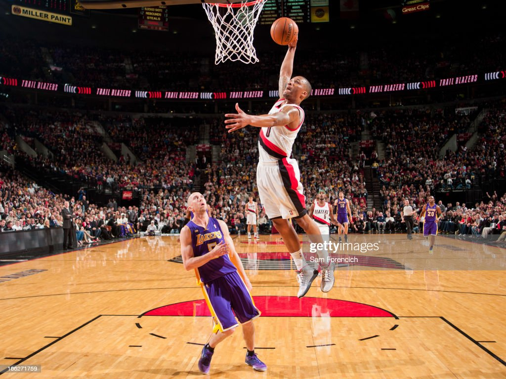 Damian Lillard of the Portland Trail Blazers rises for a dunk on a fast break against Steve Blake of the Los Angeles Lakers on April 10 2013 at the...