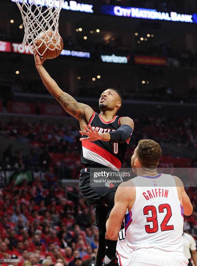 Damian Lillard of the Portland Trail Blazers scores a basket against Blake Griffin of the Los Angeles Clippers during the second half in Game Two of...