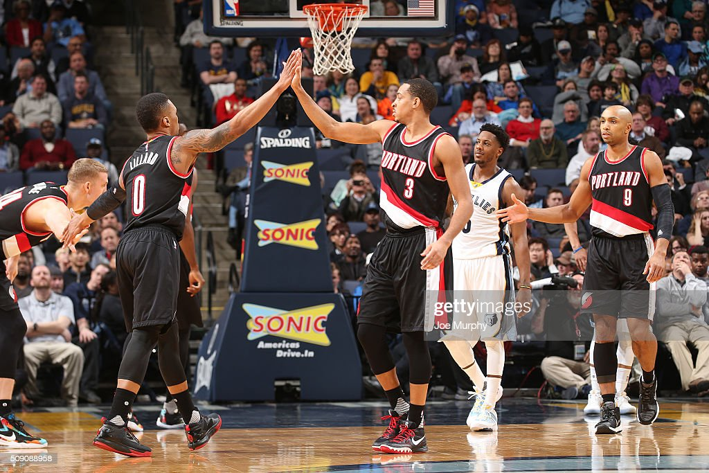 Damian Lillard #0 of the Portland Trail Blazers shakes hands with C.J. McCollum #3 of the Portland Trail Blazers during the game against the Memphis Grizzlies on February 8, 2016 at FedExForum in Memphis, Tennessee.