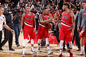 Damian Lillard of the Portland Trail Blazers shakes hands with his teammates Allen Crabbe and CJ McCollum of the Portland Trail Blazers after the...