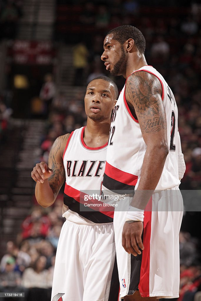<a gi-track='captionPersonalityLinkClicked' href=/galleries/search?phrase=Damian+Lillard&family=editorial&specificpeople=6598327 ng-click='$event.stopPropagation()'>Damian Lillard</a> #0 of the Portland Trail Blazers shares a word with teammate <a gi-track='captionPersonalityLinkClicked' href=/galleries/search?phrase=LaMarcus+Aldridge&family=editorial&specificpeople=453277 ng-click='$event.stopPropagation()'>LaMarcus Aldridge</a> #12 during the game against the Golden State Warriors on April 17, 2013 at the Rose Garden Arena in Portland, Oregon.