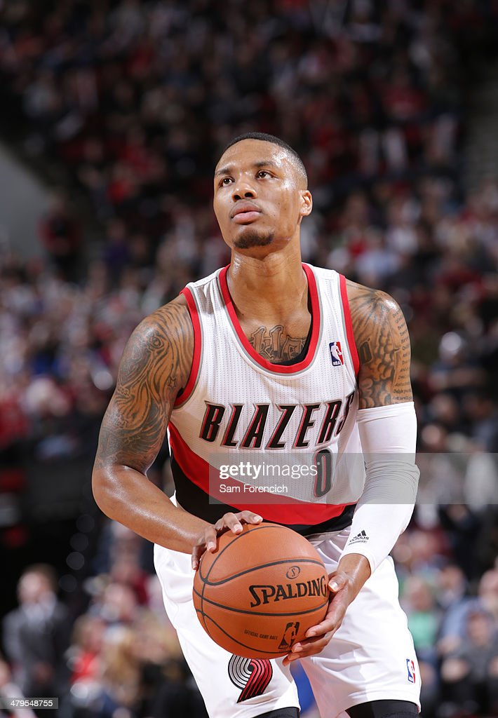 <a gi-track='captionPersonalityLinkClicked' href=/galleries/search?phrase=Damian+Lillard&family=editorial&specificpeople=6598327 ng-click='$event.stopPropagation()'>Damian Lillard</a> #0 of the Portland Trail Blazers shoots a foul shot against the Milwaukee Bucks on March 18, 2014 at the Moda Center Arena in Portland, Oregon.