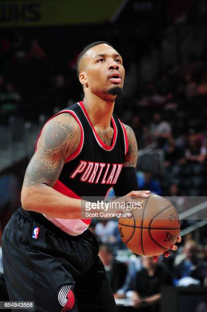 Damian Lillard of the Portland Trail Blazers shoots a free throw against the Atlanta Hawks during the game on March 18 2017 at Philips Arena in...