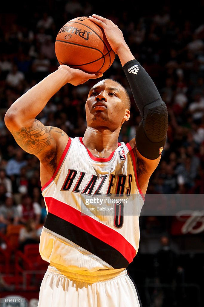 <a gi-track='captionPersonalityLinkClicked' href=/galleries/search?phrase=Damian+Lillard&family=editorial&specificpeople=6598327 ng-click='$event.stopPropagation()'>Damian Lillard</a> #0 of the Portland Trail Blazers shoots a free-throw against the Miami Heat on February 12, 2013 at American Airlines Arena in Miami, Florida.
