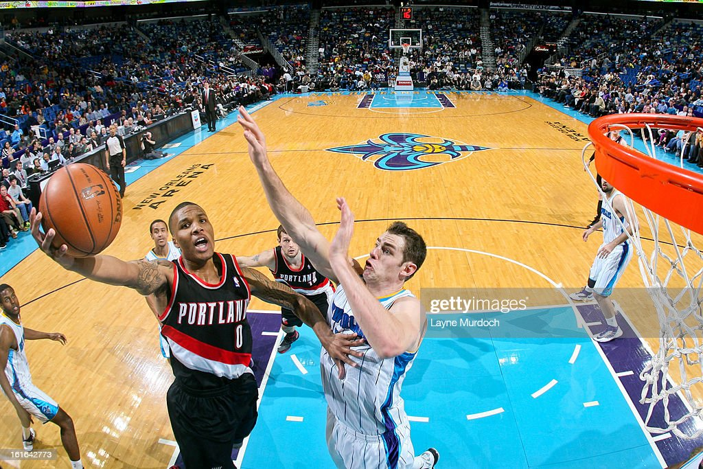 Damian Lillard #0 of the Portland Trail Blazers shoots a layup against Jason Smith #14 of the New Orleans Hornets on February 13, 2013 at the New Orleans Arena in New Orleans, Louisiana.