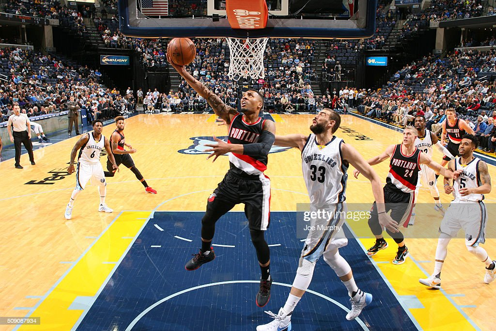 <a gi-track='captionPersonalityLinkClicked' href=/galleries/search?phrase=Damian+Lillard&family=editorial&specificpeople=6598327 ng-click='$event.stopPropagation()'>Damian Lillard</a> #0 of the Portland Trail Blazers shoots a lay up against <a gi-track='captionPersonalityLinkClicked' href=/galleries/search?phrase=Marc+Gasol&family=editorial&specificpeople=661205 ng-click='$event.stopPropagation()'>Marc Gasol</a> #33 of the Memphis Grizzlies on February 8, 2016 at FedExForum in Memphis, Tennessee.