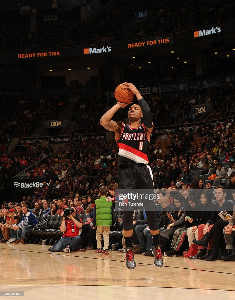 <a gi-track='captionPersonalityLinkClicked' href=/galleries/search?phrase=Damian+Lillard&family=editorial&specificpeople=6598327 ng-click='$event.stopPropagation()'>Damian Lillard</a> #0 of the Portland Trail Blazers shoots a three pointer against the Toronto Raptors during the game on November 17, 2013 at the Air Canada Centre in Toronto, Ontario, Canada.