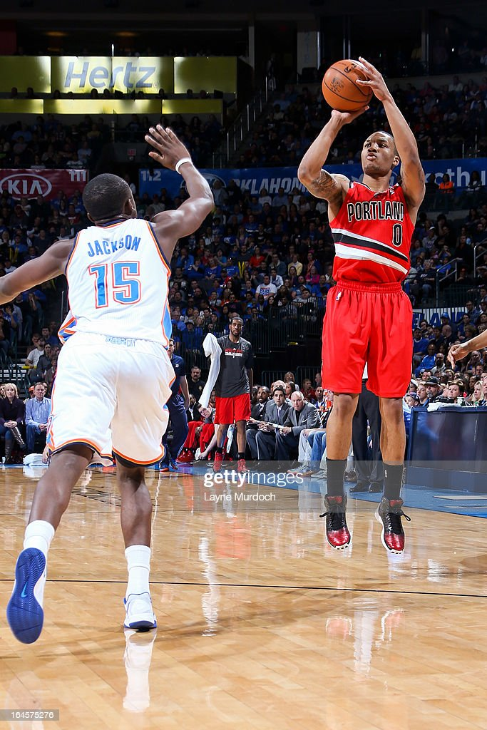 Damian Lillard #0 of the Portland Trail Blazers shoots a three-pointer against Reggie Jackson #15 of the Oklahoma City Thunder on March 24, 2013 at the Chesapeake Energy Arena in Oklahoma City, Oklahoma.