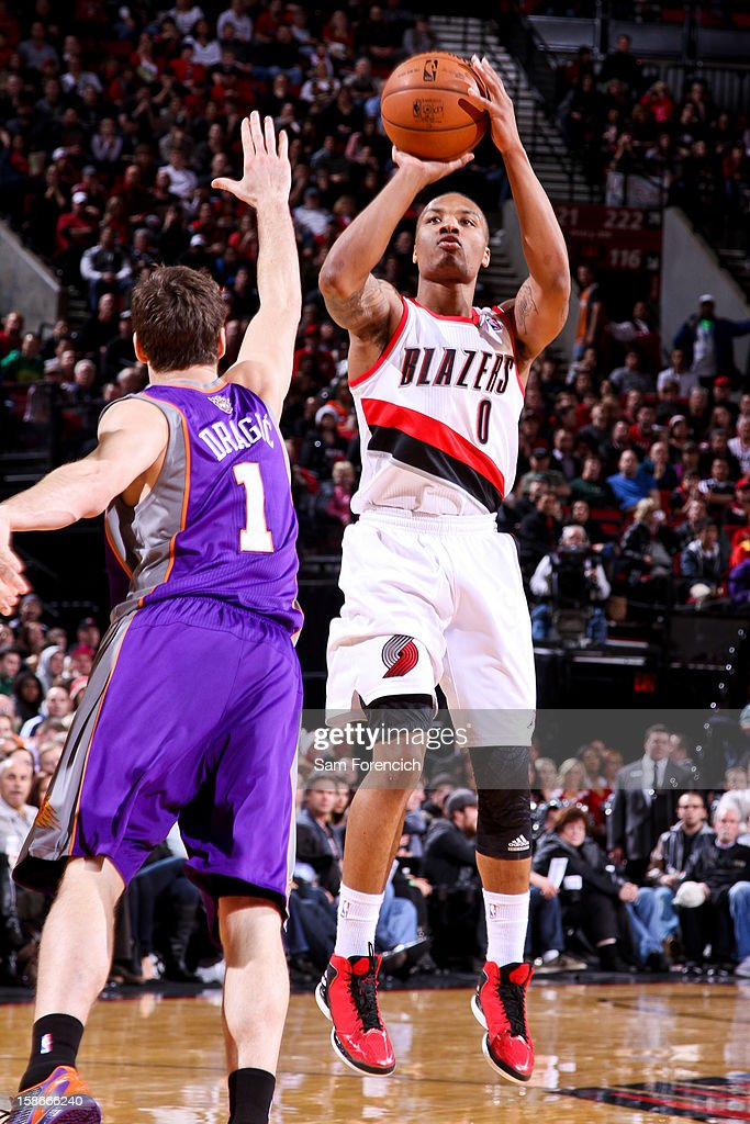 <a gi-track='captionPersonalityLinkClicked' href=/galleries/search?phrase=Damian+Lillard&family=editorial&specificpeople=6598327 ng-click='$event.stopPropagation()'>Damian Lillard</a> #0 of the Portland Trail Blazers shoots against <a gi-track='captionPersonalityLinkClicked' href=/galleries/search?phrase=Goran+Dragic&family=editorial&specificpeople=4452965 ng-click='$event.stopPropagation()'>Goran Dragic</a> #1 of the Phoenix Suns on December 22, 2012 at the Rose Garden Arena in Portland, Oregon.