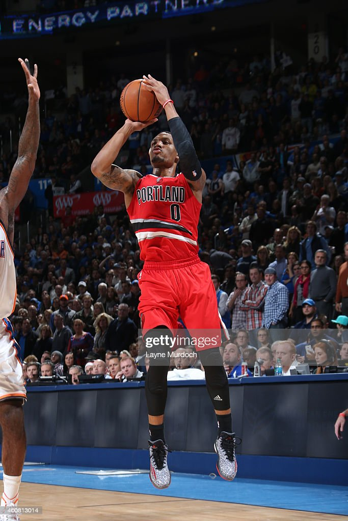 Damian Lillard of the Portland Trail Blazers shoots against the Oklahoma City Thunder on December 23 2014 at Chesapeake Energy Arena in Oklahoma City...