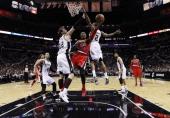 Damian Lillard of the Portland Trail Blazers shoots between Tiago Splitter and Kawhi Leonard of the San Antonio Spurs in Game Five of the Western...