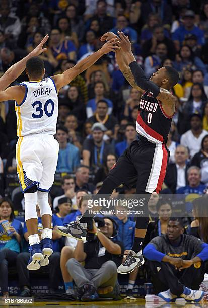 Damian Lillard of the Portland Trail Blazers shoots over Stephen Curry of the Golden State Warriors during an NBA basketball game at ORACLE Arena on...