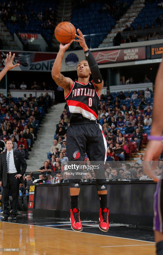 <a gi-track='captionPersonalityLinkClicked' href=/galleries/search?phrase=Damian+Lillard&family=editorial&specificpeople=6598327 ng-click='$event.stopPropagation()'>Damian Lillard</a> #0 of the Portland Trail Blazers shoots the ball against the Sacramento Kings on December 23, 2012 at Sleep Train Arena in Sacramento, California.