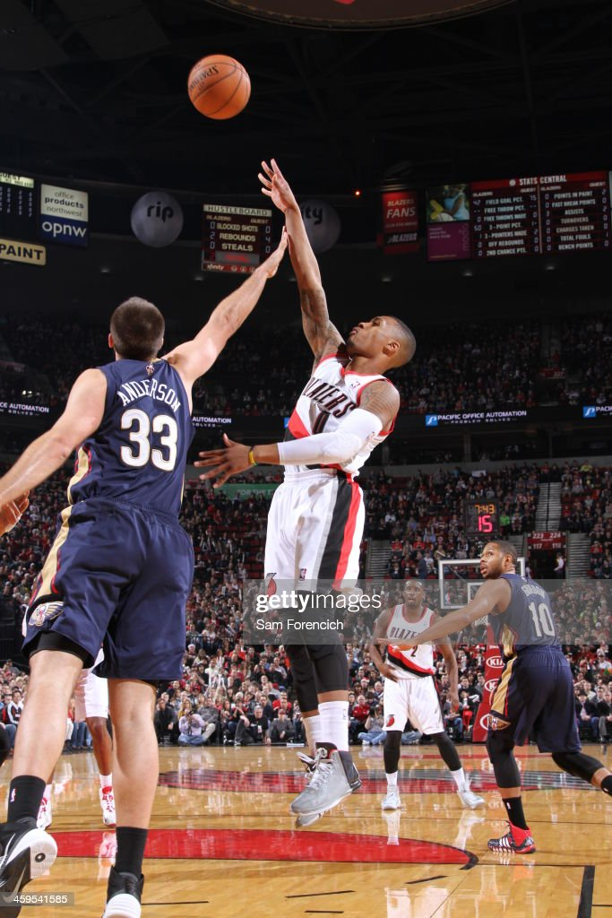 <a gi-track='captionPersonalityLinkClicked' href=/galleries/search?phrase=Damian+Lillard&family=editorial&specificpeople=6598327 ng-click='$event.stopPropagation()'>Damian Lillard</a> #0 of the Portland Trail Blazers shoots the ball against the New Orleans Pelicans on December 21, 2013 at the Moda Center Arena in Portland, Oregon.