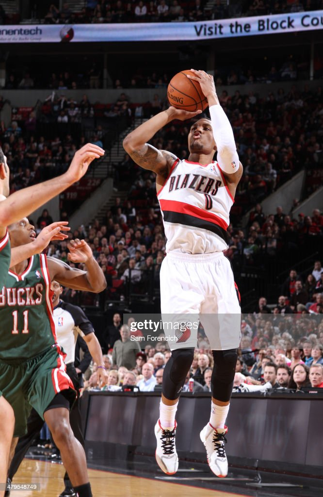 Damian Lillard #0 of the Portland Trail Blazers shoots the ball against the Milwaukee Bucks on March 18, 2014 at the Moda Center Arena in Portland, Oregon.