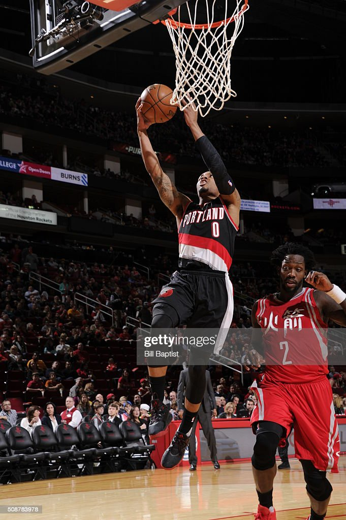 <a gi-track='captionPersonalityLinkClicked' href=/galleries/search?phrase=Damian+Lillard&family=editorial&specificpeople=6598327 ng-click='$event.stopPropagation()'>Damian Lillard</a> #0 of the Portland Trail Blazers shoots the ball against the Houston Rockets on February 6, 2016 at the Toyota Center in Houston, Texas.