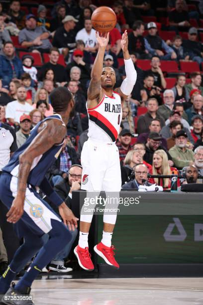 Damian Lillard of the Portland Trail Blazers shoots the ball against the Denver Nuggets on November 13 2017 at the Moda Center in Portland Oregon...