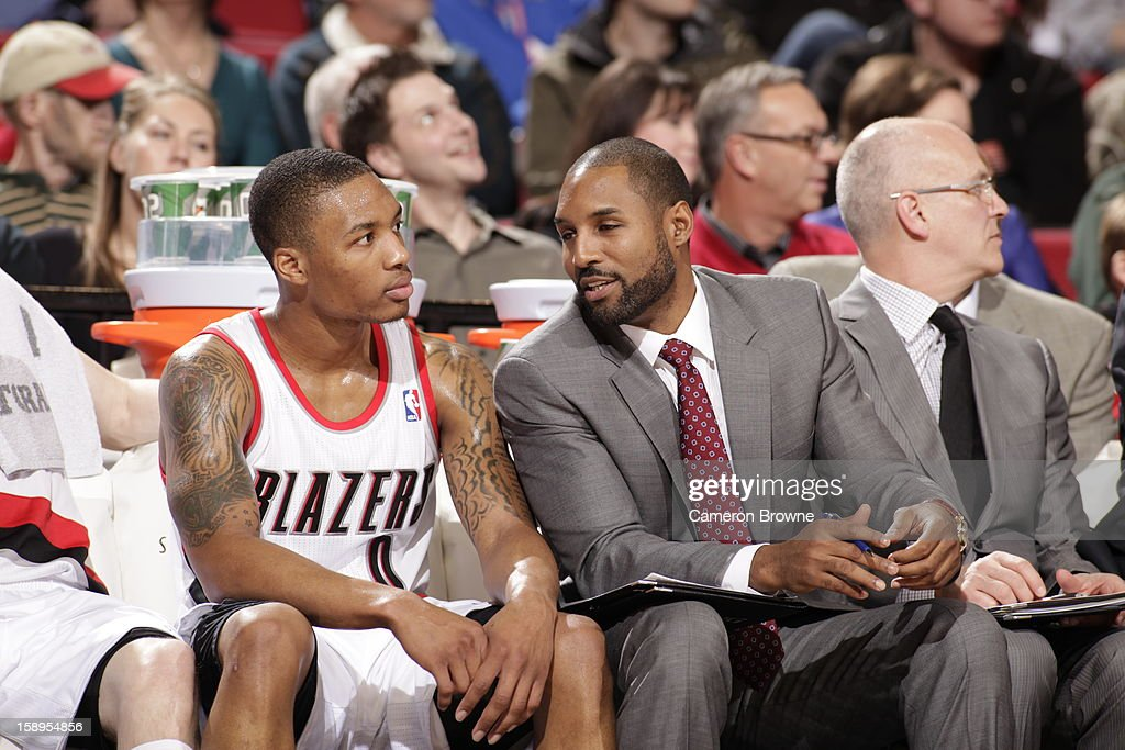 <a gi-track='captionPersonalityLinkClicked' href=/galleries/search?phrase=Damian+Lillard&family=editorial&specificpeople=6598327 ng-click='$event.stopPropagation()'>Damian Lillard</a> #0 of the Portland Trail Blazers sits on the bench during the game against the Sacramento Kings on December 26, 2012 at the Rose Garden Arena in Portland, Oregon.