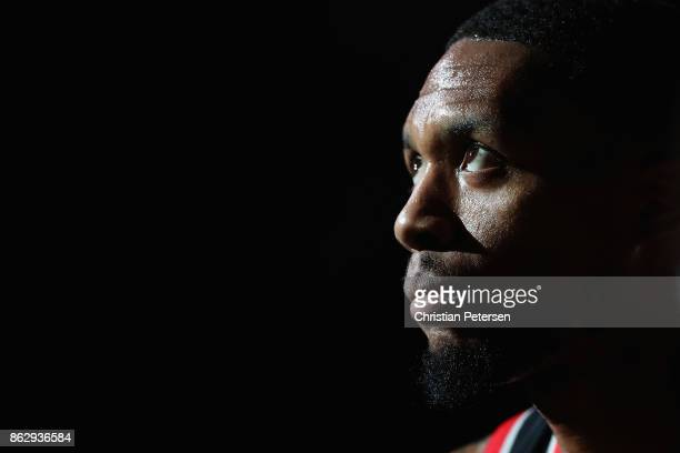 Damian Lillard of the Portland Trail Blazers sits on the bench during a time out from the first half of the NBA game against the Phoenix Suns at...