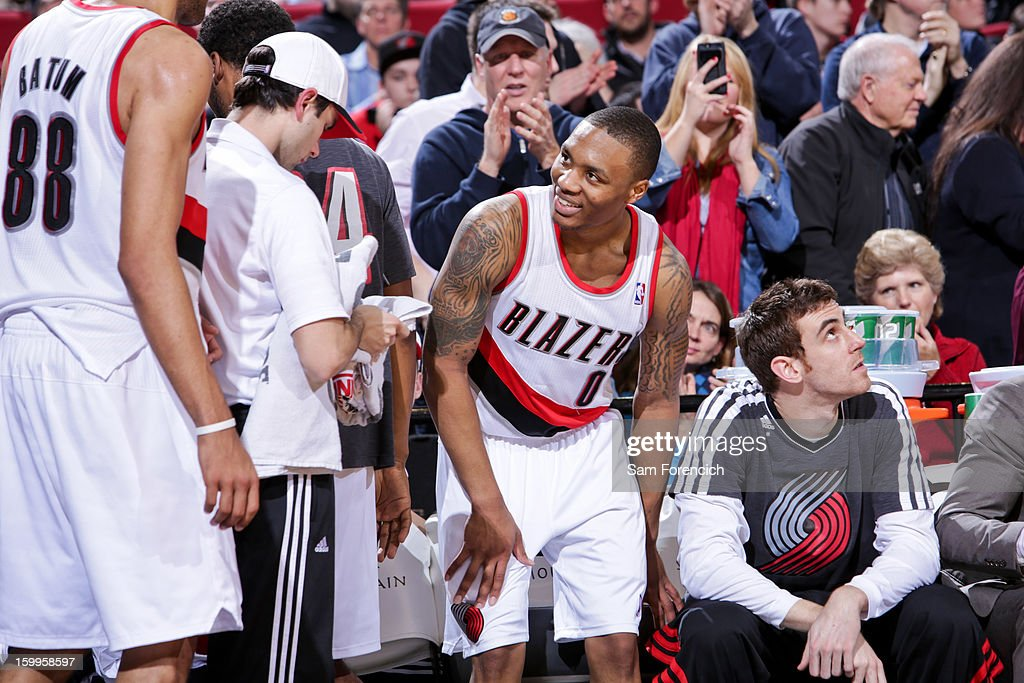 Damian Lillard #0 of the Portland Trail Blazers smiles while taking a seat on the bench during a game against the Indiana Pacers on January 23, 2013 at the Rose Garden Arena in Portland, Oregon.
