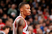 Damian Lillard of the Portland Trail Blazers stands on the court during a game against the Boston Celtics on January 22 2015 at the Moda Center Arena...