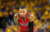 Damian Lillard of the Portland Trail Blazers stands on the court during their loss to the Golden State Warriors in Game Five of the Western...