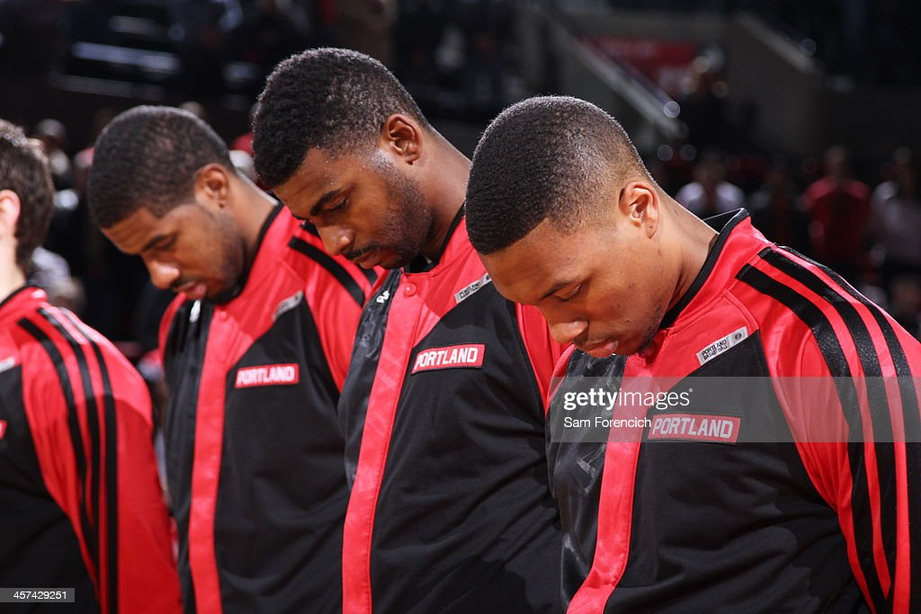 <a gi-track='captionPersonalityLinkClicked' href=/galleries/search?phrase=Damian+Lillard&family=editorial&specificpeople=6598327 ng-click='$event.stopPropagation()'>Damian Lillard</a> #0 of the Portland Trail Blazers stands on the court before the game against the Houston Rockets on November 5, 2013 at the Moda Center Arena in Portland, Oregon.
