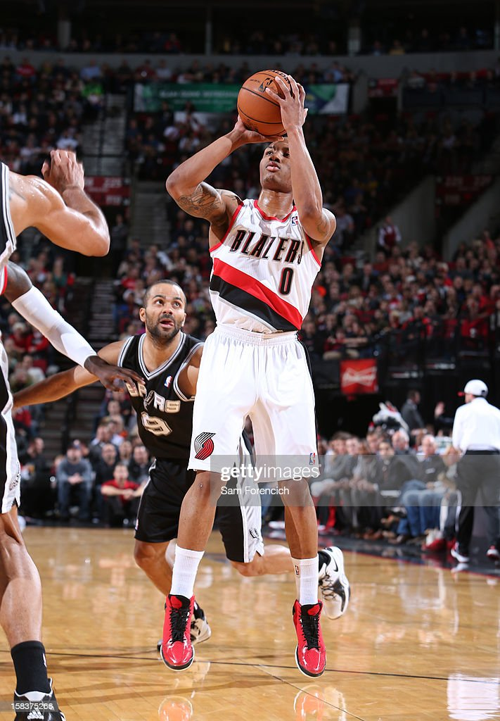<a gi-track='captionPersonalityLinkClicked' href=/galleries/search?phrase=Damian+Lillard&family=editorial&specificpeople=6598327 ng-click='$event.stopPropagation()'>Damian Lillard</a> #0 of the Portland Trail Blazers takes a shot against the San Antonio Spurs on December 13, 2012 at the Rose Garden Arena in Portland, Oregon.