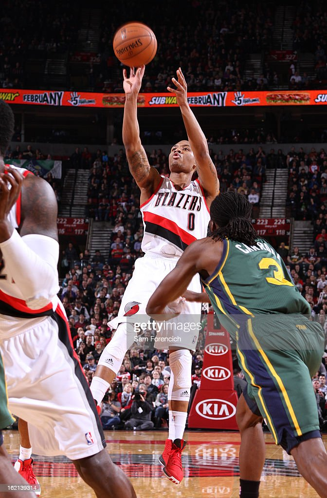 <a gi-track='captionPersonalityLinkClicked' href=/galleries/search?phrase=Damian+Lillard&family=editorial&specificpeople=6598327 ng-click='$event.stopPropagation()'>Damian Lillard</a> #0 of the Portland Trail Blazers takes a shot against the Utah Jazz on February 2, 2013 at the Rose Garden Arena in Portland, Oregon.