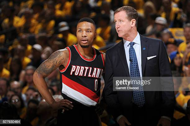 Damian Lillard of the Portland Trail Blazers talks with Terry Stotts of the Portland Trail Blazers during the game against the Golden State Warriors...