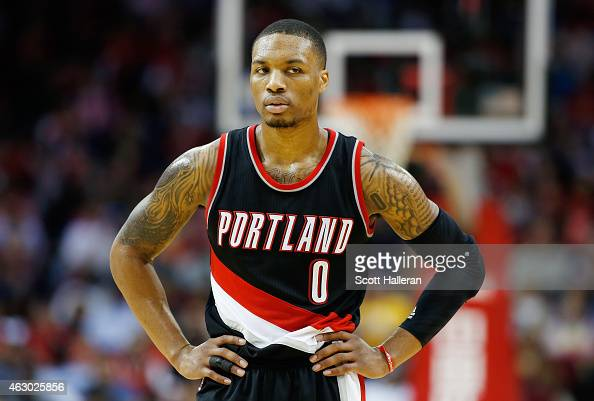 Damian Lillard of the Portland Trail Blazers waits on the court during their game against the Houston Rockets at the Toyota Center on February 8 2015...