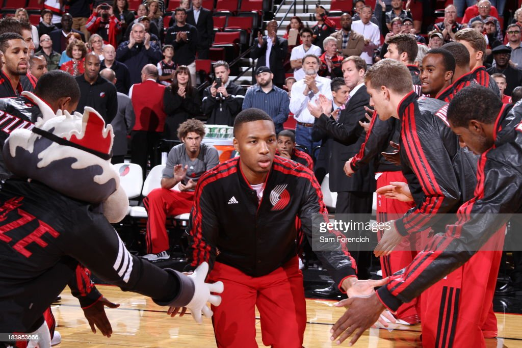 <a gi-track='captionPersonalityLinkClicked' href=/galleries/search?phrase=Damian+Lillard&family=editorial&specificpeople=6598327 ng-click='$event.stopPropagation()'>Damian Lillard</a> #0 of the Portland Trail Blazersruns out before the game against the Los Angeles Clippers on October 7, 2013 at the Moda Center Arena in Portland, Oregon.