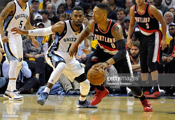 Damian Lillard of the Portland Trailblazers plays against Mike Conley of the Memphis Grizzlies during Game One of the first round of the 2015 NBA...